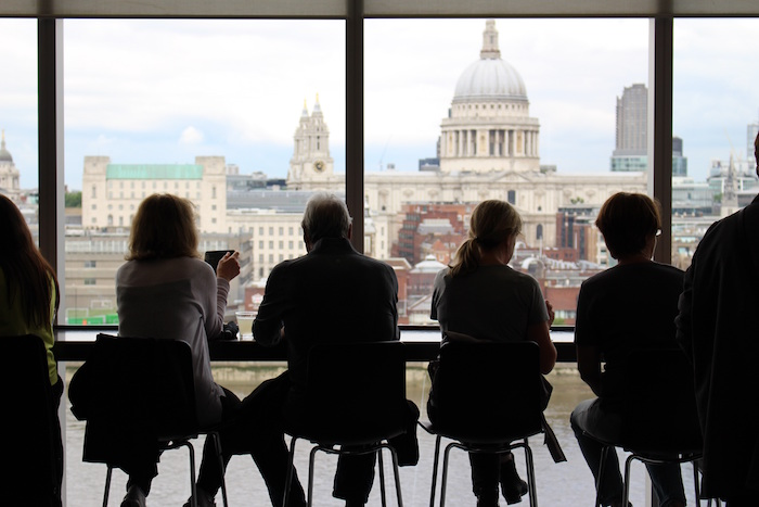 People looking out over St Paul's Cathedral, London