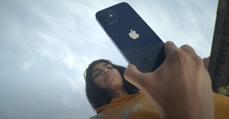 Lady holding an Apple iPhone