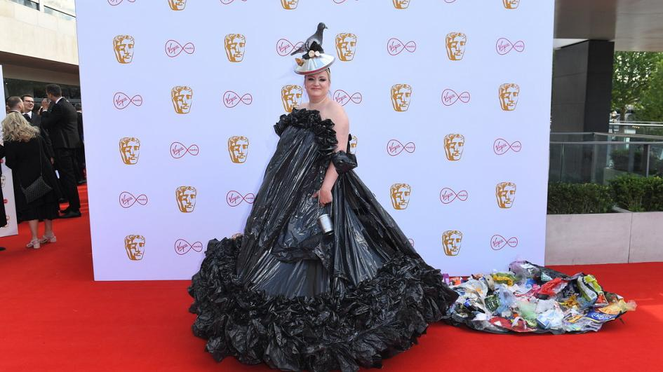 Actress daisy Cooper wears a dress made from black bin liners