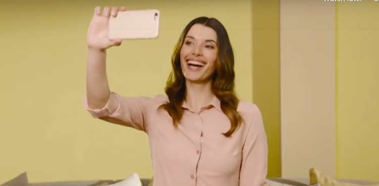 Woman takes a selfie for Dulux campaign