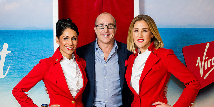 Paul McKenna stands with Virgin Air Hostesses as part of travel PR campaign