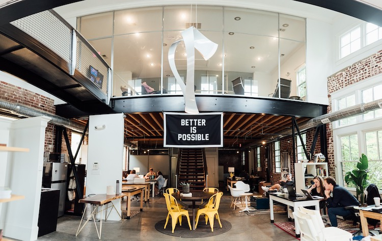 Cool creative office with Better is Possible sign