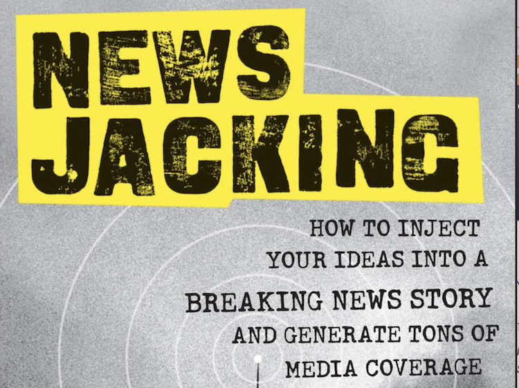 Front cover of Newsjacking book with black text on a yellow background