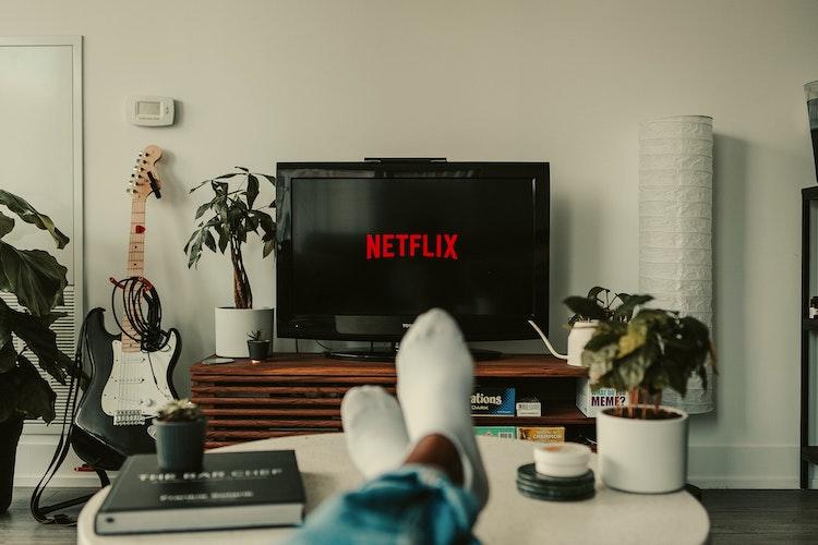 Netflix logo on large TV screen